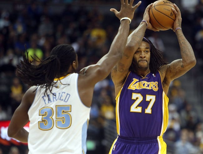 Nov 13, 2013; Denver, CO, USA;  Los Angeles Lakers forward Jordan Hill (27) during the second half against the Denver Nuggets at Pepsi Center.  The Nuggets won 111-99.  Mandatory Credit: Chris Humphreys-USA TODAY Sports