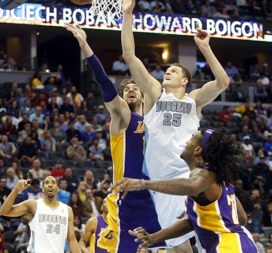 Nov 13, 2013; Denver, CO, USA;  Los Angeles Lakers forward Pau Gasol (16) has his shot blocked by Denver Nuggets center Timofey Mozgov (25) during the second half at Pepsi Center.  The Nuggets won 111-99.  Mandatory Credit: Chris Humphreys-USA TODAY Sports