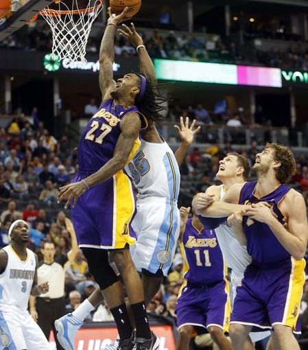 Nov 13, 2013; Denver, CO, USA;  Los Angeles Lakers forward Jordan Hill (27) shoots the ball during the second half against the Denver Nuggets at Pepsi Center.  The Nuggets won 111-99.  Mandatory Credit: Chris Humphreys-USA TODAY Sports