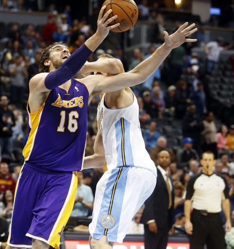 Nov 13, 2013; Denver, CO, USA;  Los Angeles Lakers forward Pau Gasol (16) shoots the ball against  Denver Nuggets center Timofey Mozgov (25) during the second half at Pepsi Center.  The Nuggets won 111-99.  Mandatory Credit: Chris Humphreys-USA TODAY Sports
