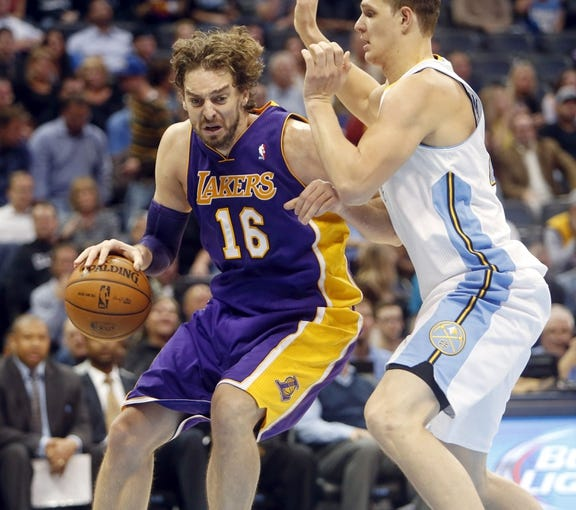 Nov 13, 2013; Denver, CO, USA;  Los Angeles Lakers forward Pau Gasol (16) drives to the basket against  Denver Nuggets center Timofey Mozgov (25) during the second half at Pepsi Center.  The Nuggets won 111-99.  Mandatory Credit: Chris Humphreys-USA TODAY Sports