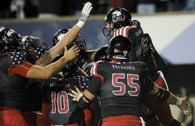 Nov 13, 2013; DeKalb, IL, USA;  Northern Illinois Cardinals quarterback Jordan Lynch (6) is congratulated after scoring a touchdown in the 4th quarter against the Ball State Huskies at Huskie Stadium. Mandatory Credit: Matt Marton-USA TODAY Sports