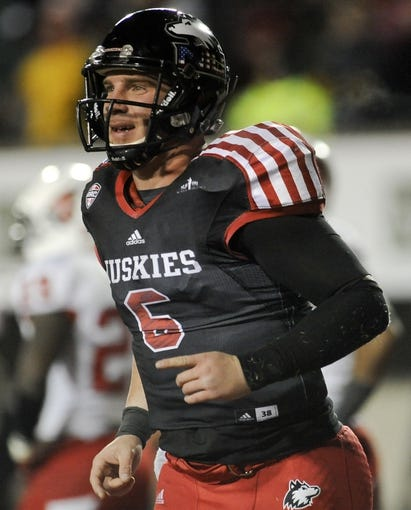 Nov 13, 2013; DeKalb, IL, USA;  Northern Illinois Cardinals quarterback Jordan Lynch (6) smiles after he scored a touchdown in the 4th quarter against the Ball State Huskies at Huskie Stadium. Mandatory Credit: Matt Marton-USA TODAY Sports