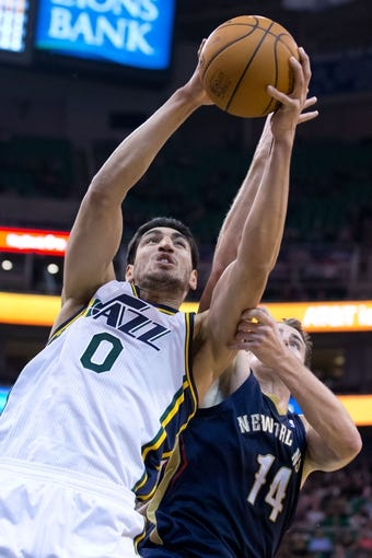 Nov 13, 2013; Salt Lake City, UT, USA; Utah Jazz center Enes Kanter (0) grabs a rebound over New Orleans Pelicans center Jason Smith (14) during the second half at EnergySolutions Arena. The Jazz won 111-105. Mandatory Credit: Russ Isabella-USA TODAY Sports