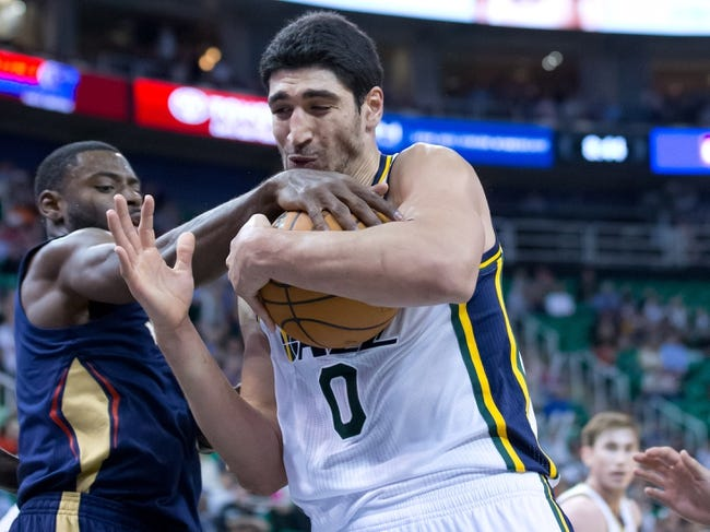 Nov 13, 2013; Salt Lake City, UT, USA; Utah Jazz center Enes Kanter (0) battles for a rebound with New Orleans Pelicans point guard Tyreke Evans (1) during the second half at EnergySolutions Arena. The Jazz won 111-105. Mandatory Credit: Russ Isabella-USA TODAY Sports