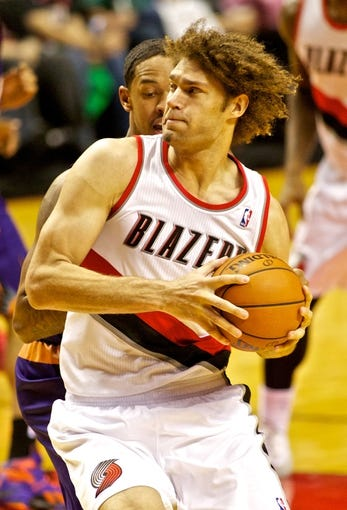 Nov 13, 2013; Portland, OR, USA; Portland Trail Blazers center Robin Lopez (42) drives to the basket against the Phoenix Suns at the Moda Center. Mandatory Credit: Craig Mitchelldyer-USA TODAY Sports