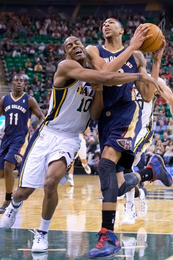 Nov 13, 2013; Salt Lake City, UT, USA; New Orleans Pelicans power forward Anthony Davis (23) is fouled by Utah Jazz point guard Alec Burks (10) during the second half at EnergySolutions Arena. The Jazz won 111-105. Mandatory Credit: Russ Isabella-USA TODAY Sports