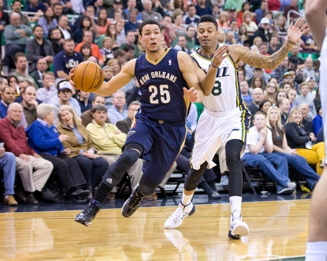 Nov 13, 2013; Salt Lake City, UT, USA; New Orleans Pelicans shooting guard Austin Rivers (25) dribbles around Utah Jazz guard Diante Garrett (8) during the second half at EnergySolutions Arena. The Jazz won 111-105. Mandatory Credit: Russ Isabella-USA TODAY Sports