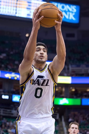 Nov 13, 2013; Salt Lake City, UT, USA; Utah Jazz center Enes Kanter (0) grabs a rebound during the second half against the New Orleans Pelicans at EnergySolutions Arena. The Jazz won 111-105. Mandatory Credit: Russ Isabella-USA TODAY Sports