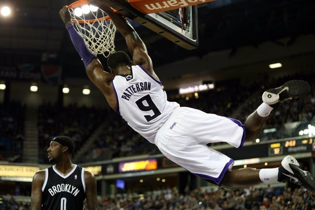 Nov 13, 2013; Sacramento, CA, USA; Sacramento Kings power forward Patrick Patterson (9) hangs onto the rim after a dunk against the Brooklyn Nets during the third quarter at Sleep Train Arena. The Sacramento Kings defeated the Brooklyn Nets 107-86. Mandatory Credit: Kelley L Cox-USA TODAY Sports
