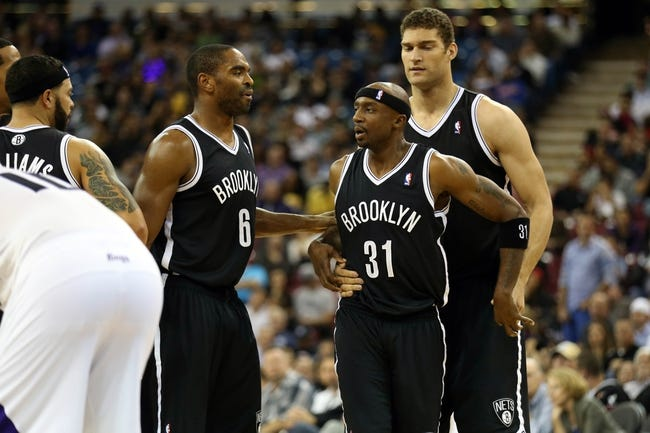Nov 13, 2013; Sacramento, CA, USA; Brooklyn Nets shooting guard Alan Anderson (6) and center Brook Lopez (11) hold back shooting guard Jason Terry (31) as he is called for a technical against Sacramento Kings point guard Greivis Vasquez (10) during the fourth quarter at Sleep Train Arena. The Sacramento Kings defeated the Brooklyn Nets 107-86. Mandatory Credit: Kelley L Cox-USA TODAY Sports