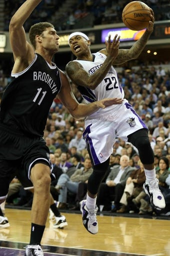 Nov 13, 2013; Sacramento, CA, USA; Sacramento Kings point guard Isaiah Thomas (22) drives in against Brooklyn Nets center Brook Lopez (11) before passing out the ball during the fourth quarter at Sleep Train Arena. The Sacramento Kings defeated the Brooklyn Nets 107-86. Mandatory Credit: Kelley L Cox-USA TODAY Sports