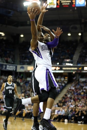 Nov 13, 2013; Sacramento, CA, USA; Sacramento Kings shooting guard Marcus Thornton (23) goes up for a basket against Brooklyn Nets shooting guard Alan Anderson (6) during the fourth quarter at Sleep Train Arena. The Sacramento Kings defeated the Brooklyn Nets 107-86. Mandatory Credit: Kelley L Cox-USA TODAY Sports