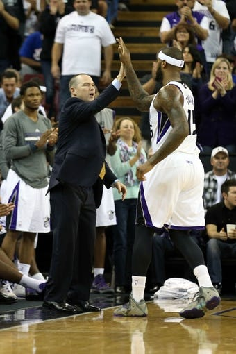 Nov 13, 2013; Sacramento, CA, USA; Sacramento Kings head coach Michael Malone high fives center DeMarcus Cousins (15) as he fouls out of the game against the Brooklyn Nets during the fourth quarter at Sleep Train Arena. The Sacramento Kings defeated the Brooklyn Nets 107-86. Mandatory Credit: Kelley L Cox-USA TODAY Sports