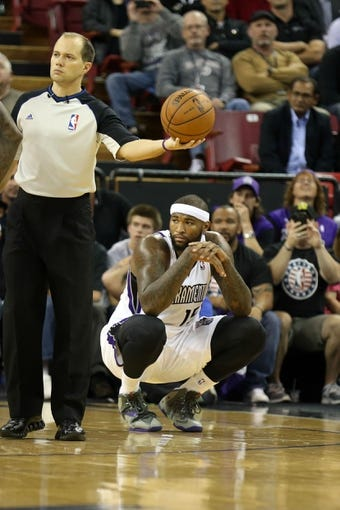 Nov 13, 2013; Sacramento, CA, USA; Sacramento Kings center DeMarcus Cousins (15) squats on the court after fouling out of the game against the Brooklyn Nets during the fourth quarter at Sleep Train Arena. The Sacramento Kings defeated the Brooklyn Nets 107-86. Mandatory Credit: Kelley L Cox-USA TODAY Sports