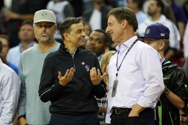 Nov 13, 2013; Sacramento, CA, USA; Sacramento Kings majority owner Vivek Ranadive (left) smiles with minority owner Mark Mastrov in the final seconds of the game against the Brooklyn Nets during the fourth quarter at Sleep Train Arena. The Sacramento Kings defeated the Brooklyn Nets 107-86. Mandatory Credit: Kelley L Cox-USA TODAY Sports