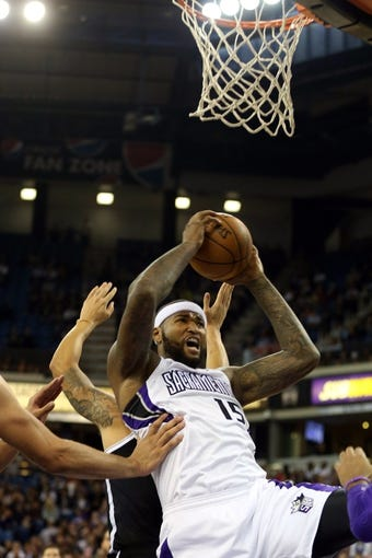 Nov 13, 2013; Sacramento, CA, USA; Brooklyn Nets shooting guard Alan Anderson (6) commits a foul against Sacramento Kings center DeMarcus Cousins (15) as he pulls in a rebound during the fourth quarter at Sleep Train Arena. The Sacramento Kings defeated the Brooklyn Nets 107-86. Mandatory Credit: Kelley L Cox-USA TODAY Sports