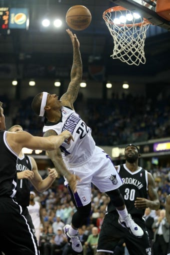 Nov 13, 2013; Sacramento, CA, USA; Sacramento Kings point guard Isaiah Thomas (22) is fouled by Brooklyn Nets power forward Mirza Teletovic (33) during the fourth quarter at Sleep Train Arena. The Sacramento Kings defeated the Brooklyn Nets 107-86. Mandatory Credit: Kelley L Cox-USA TODAY Sports