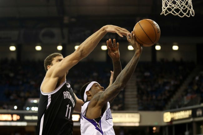 Nov 13, 2013; Sacramento, CA, USA; Brooklyn Nets center Brook Lopez (11) defends the shot by Sacramento Kings small forward John Salmons (5) during the fourth quarter at Sleep Train Arena. The Sacramento Kings defeated the Brooklyn Nets 107-86. Mandatory Credit: Kelley L Cox-USA TODAY Sports