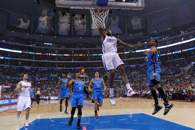 Nov 13, 2013; Los Angeles, CA, USA; Los Angeles Clippers center DeAndre Jordan (6) dunks the ball against the Oklahoma City Thunder at Staples Center. The Clippers defeated the Thunder 111-103. Mandatory Credit: Kirby Lee-USA TODAY Sports