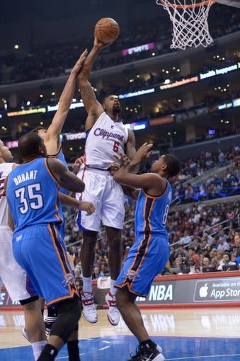 Nov 13, 2013; Los Angeles, CA, USA; Los Angeles Clippers center DeAndre Jordan (6) shoots the ball against the Oklahoma City Thunder at Staples Center. The Clippers defeated the Thunder 111-103. Mandatory Credit: Kirby Lee-USA TODAY Sports