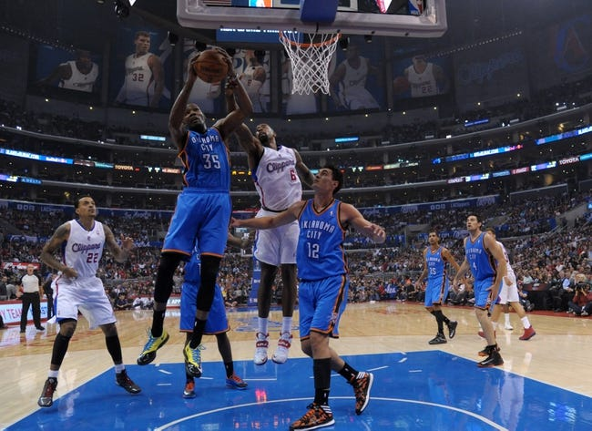 Nov 13, 2013; Los Angeles, CA, USA; Oklahoma City Thunder forward Kevin Durant (35) and Los Angeles Clippers center DeAndre Jordan (6) battle for rebound at Staples Center. The Clippers defeated the Thunder 111-103. Mandatory Credit: Kirby Lee-USA TODAY Sports