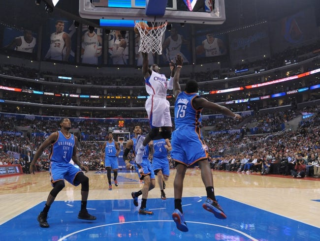 Nov 13, 2013; Los Angeles, CA, USA; Los Angeles Clippers guard Darren Collison (2) shoots the ball against the Oklahoma City Thunder at Staples Center. The Clippers defeated the Thunder 111-103. Mandatory Credit: Kirby Lee-USA TODAY Sports