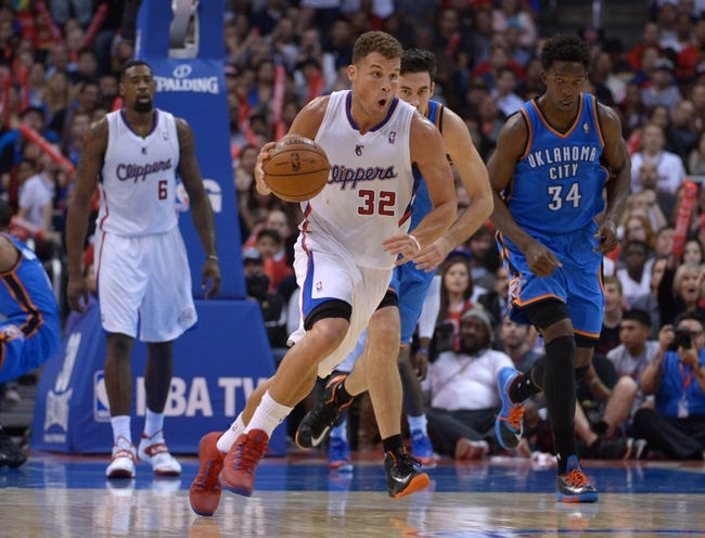Nov 13, 2013; Los Angeles, CA, USA; Los Angeles Clippers forward Blake Griffin (32) dribbles the ball against the Oklahoma City Thunder at Staples Center. The Clippers defeated the Thunder 111-103. Mandatory Credit: Kirby Lee-USA TODAY Sports
