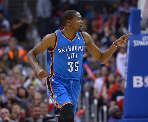 Nov 13, 2013; Los Angeles, CA, USA; Oklahoma City Thunder forward Kevin Durant (35) reacts during the game against the Los Angeles Clippers at Staples Center. The Clippers defeated the Thunder 111-103. Mandatory Credit: Kirby Lee-USA TODAY Sports
