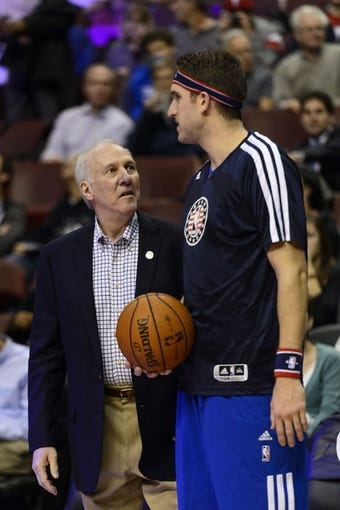 Nov 11, 2013; Philadelphia, PA, USA; San Antonio Spurs head coach Gregg Popovich talks with Philadelphia 76ers center Spencer Hawes (00) prior to the start of the game at Wells Fargo Center. The Spurs defeated the Sixers 109-85. Mandatory Credit: Howard Smith-USA TODAY Sports