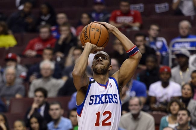 Nov 11, 2013; Philadelphia, PA, USA; Philadelphia 76ers guard Evan Turner (12) shoots a jump shot during the first quarter against the San Antonio Spurs at Wells Fargo Center. The Spurs defeated the Sixers 109-85. Mandatory Credit: Howard Smith-USA TODAY Sports