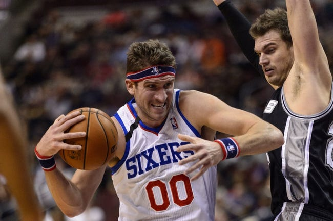 Nov 11, 2013; Philadelphia, PA, USA; Philadelphia 76ers center Spencer Hawes (00) is defended by San Antonio Spurs center Tiago Splitter (22) during the first quarter at Wells Fargo Center. The Spurs defeated the Sixers 109-85. Mandatory Credit: Howard Smith-USA TODAY Sports