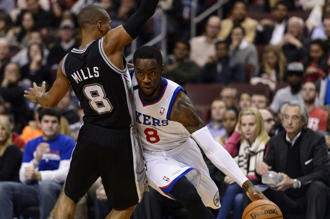 Nov 11, 2013; Philadelphia, PA, USA; Philadelphia 76ers guard Tony Wroten (8) is defended by San Antonio Spurs guard Patty Mills (8) during the first quarter at Wells Fargo Center. The Spurs defeated the Sixers 109-85. Mandatory Credit: Howard Smith-USA TODAY Sports