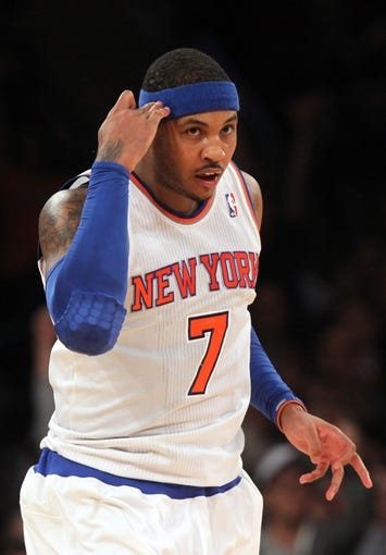 Nov 14, 2013; New York, NY, USA; New York Knicks small forward Carmelo Anthony (7) signals after hitting a three-point shot against the Houston Rockets during the second quarter of a game at Madison Square Garden. Mandatory Credit: Brad Penner-USA TODAY Sports