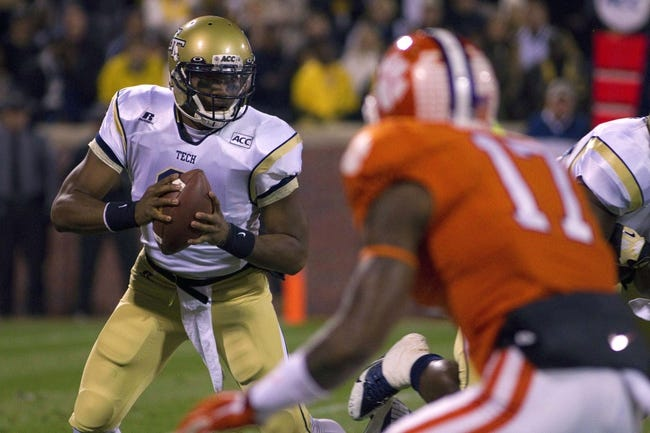 Nov 14, 2013; Clemson, SC, USA; Georgia Tech Yellow Jackets quarterback Vad Lee (2) carries the ball during the first quarter against the Clemson Tigers at Clemson Memorial Stadium. Mandatory Credit: Joshua S. Kelly-USA TODAY Sports