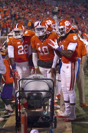 Nov 14, 2013; Clemson, SC, USA; Clemson Tigers running back D.J. Howard (22), quarterback Tajh Boyd (10) and wide receiver Sammy Watkins (2) on the sidelines during the second quarter against the Georgia Tech Yellow Jackets at Clemson Memorial Stadium. Clemson won 55-24. Mandatory Credit: Joshua S. Kelly-USA TODAY Sports