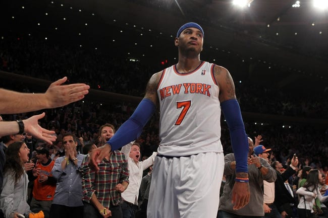 Nov 14, 2013; New York, NY, USA; New York Knicks small forward Carmelo Anthony (7) and fans react after he was fouled late during the fourth quarter of a game against the Houston Rockets at Madison Square Garden. Mandatory Credit: Brad Penner-USA TODAY Sports