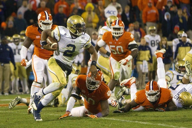 Nov 14, 2013; Clemson, SC, USA; Georgia Tech Yellow Jackets quarterback Vad Lee (2) carries the ball during the fourth quarter against the Clemson Tigers at Clemson Memorial Stadium. Clemson won 55-31. Mandatory Credit: Joshua S. Kelly-USA TODAY Sports