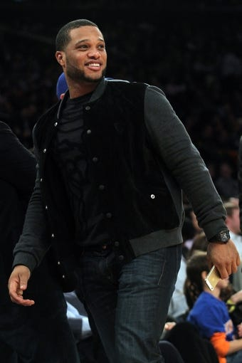 Nov 14, 2013; New York, NY, USA; Free agent second baseman Robinson Cano on the sidelines during the fourth quarter of a game between the New York Knicks and the Houston Rockets at Madison Square Garden. The Rockets beat the Knicks 109-106. Mandatory Credit: Brad Penner-USA TODAY Sports