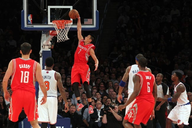Nov 14, 2013; New York, NY, USA; Houston Rockets point guard Jeremy Lin (7) dunks against the New York Knicks during the fourth quarter of a game at Madison Square Garden. The Rockets beat the Knicks 109-106. Mandatory Credit: Brad Penner-USA TODAY Sports