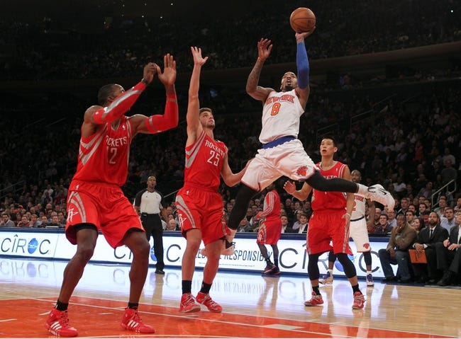 Nov 14, 2013; New York, NY, USA; New York Knicks shooting guard J.R. Smith (8) shoots over Houston Rockets small forward Chandler Parsons (25) and Rockets power forward Dwight Howard (12) and Rockets point guard Jeremy Lin (7) during the fourth quarter of a game at Madison Square Garden. The Rockets beat the Knicks 109-106. Mandatory Credit: Brad Penner-USA TODAY Sports