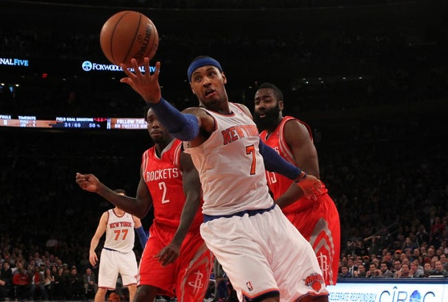 Nov 14, 2013; New York, NY, USA; New York Knicks small forward Carmelo Anthony (7) grabs a rebound in front of Houston Rockets point guard Patrick Beverley (2) and Rockets shooting guard James Harden (13) during the fourth quarter of a game at Madison Square Garden. The Rockets beat the Knicks 109-106. Mandatory Credit: Brad Penner-USA TODAY Sports