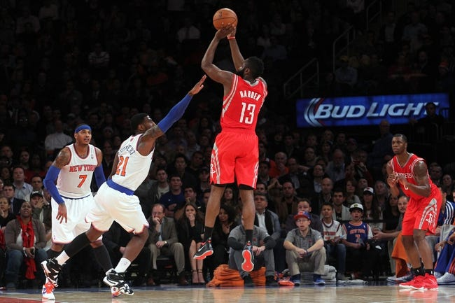 Nov 14, 2013; New York, NY, USA; Houston Rockets shooting guard James Harden (13) shoots over New York Knicks shooting guard Iman Shumpert (21) during the fourth quarter of a game at Madison Square Garden. The Rockets beat the Knicks 109-106. Mandatory Credit: Brad Penner-USA TODAY Sports