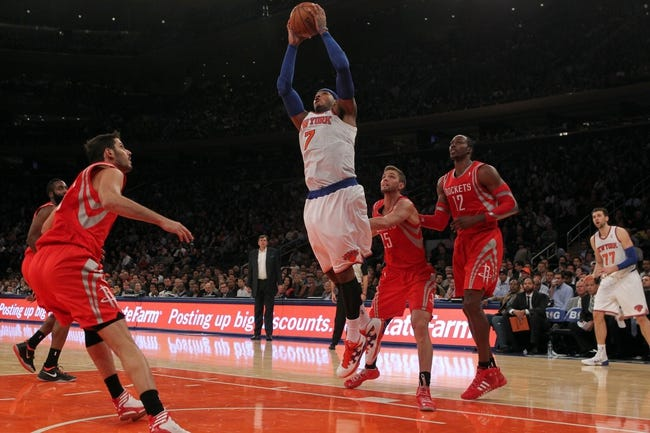 Nov 14, 2013; New York, NY, USA; New York Knicks small forward Carmelo Anthony (7) goes to the basket against Houston Rockets small forward Chandler Parsons (25) and Rockets power forward Dwight Howard (12) during the third quarter of a game at Madison Square Garden. The Rockets beat the Knicks 109-106. Mandatory Credit: Brad Penner-USA TODAY Sports