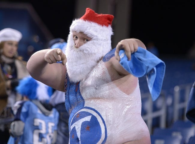 Nov 14, 2013; Nashville, TN, USA; Tennessee Titans fan Andrew Marmaman poses with body paint and a Santa Claus hat and beard during the game against the Indianapolis Colts at LP Field. TMandatory Credit: Kirby Lee-USA TODAY Sports