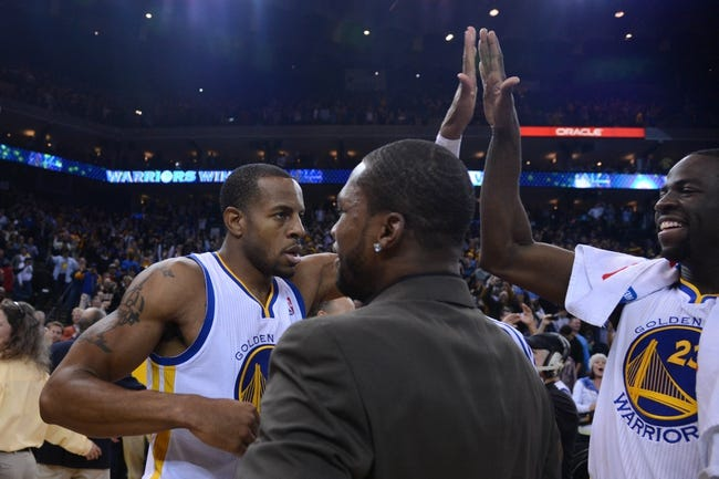 November 14, 2013; Oakland, CA, USA; Golden State Warriors small forward Andre Iguodala (9, left) is congratulated by small forward Draymond Green (23, right) after the game against the Oklahoma City Thunder at Oracle Arena. The Warriors defeated the Thunder 116-115. Mandatory Credit: Kyle Terada-USA TODAY Sports