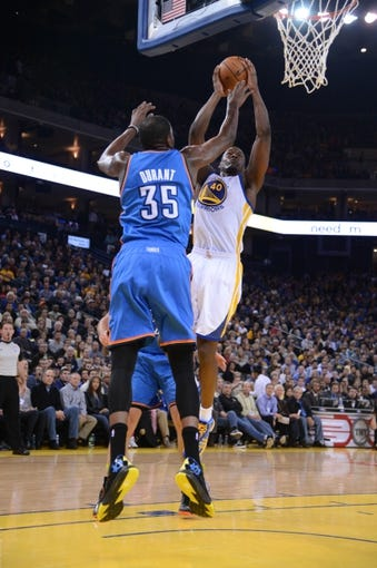 November 14, 2013; Oakland, CA, USA; Golden State Warriors small forward Harrison Barnes (40) shoots the ball against Oklahoma City Thunder small forward Kevin Durant (35) during the third quarter at Oracle Arena. The Warriors defeated the Thunder 116-115. Mandatory Credit: Kyle Terada-USA TODAY Sports