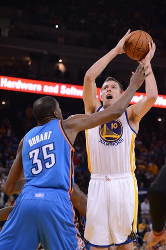 November 14, 2013; Oakland, CA, USA; Golden State Warriors power forward David Lee (10) shoots the ball against Oklahoma City Thunder small forward Kevin Durant (35) during the fourth quarter at Oracle Arena. The Warriors defeated the Thunder 116-115. Mandatory Credit: Kyle Terada-USA TODAY Sports