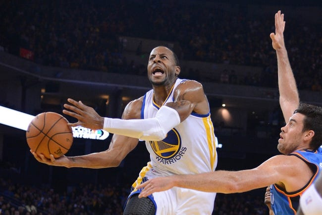 November 14, 2013; Oakland, CA, USA; Golden State Warriors small forward Andre Iguodala (9, left) shoots the ball against Oklahoma City Thunder power forward Nick Collison (4, right) during the third quarter at Oracle Arena. The Warriors defeated the Thunder 116-115. Mandatory Credit: Kyle Terada-USA TODAY Sports