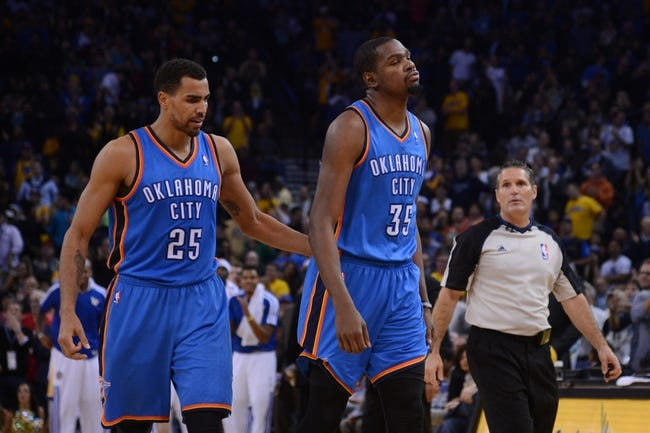 November 14, 2013; Oakland, CA, USA; Oklahoma City Thunder small forward Kevin Durant (35) reacts in front of shooting guard Thabo Sefolosha (25) during the fourth quarter against the Golden State Warriors at Oracle Arena. The Warriors defeated the Thunder 116-115. Mandatory Credit: Kyle Terada-USA TODAY Sports